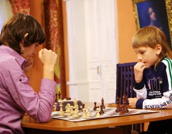 Девятилетний Антон Сидоров  из Иркутской области  занял второе место на чемпионате  Европы по шахматам среди школьников. Фото: Николай Ошкай/Великая Эпоха (The Epoch Times)