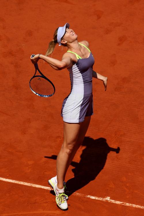 Мария Шарапова встретилась в четвертьфинале с Еленой Янукович, проведя напряжённый матч. Фото: Clive Brunskill/Getty Images