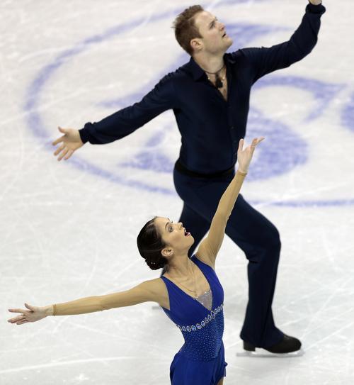 Вера Базарова и Юрий Ларионов на чемпионате мира по фигурному катанию. Фото: Geoff Robins/AFP/Getty Images
