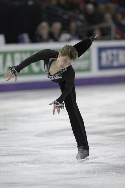 Максим Ковтун исполняет короткую программу на чемпионате мира по фигурному катанию. Фото: BRENDAN SMIALOWSKI/AFP/Getty Images