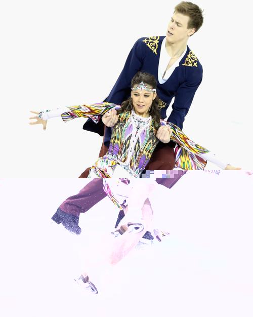 Елена Ильиных и Никита Кацалапов в короткой программе на ЧМ по фигурному катанию в канадском Лондоне, 14 марта 2013 года. Фото: Ronald Martinez/Getty Images