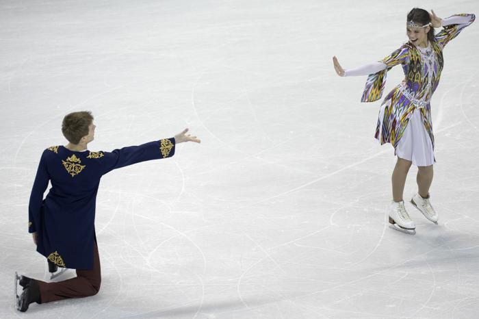 Елена Ильиных и Никита Кацалапов в короткой программе на ЧМ по фигурному катанию в канадском Лондоне, 14 марта 2013 года. Фото: BRENDAN SMIALOWSKI/AFP/Getty Images