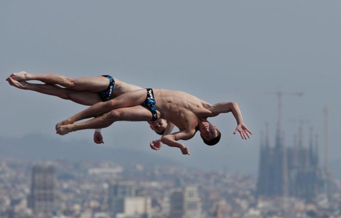 Виктор Минибаев и Артем Чесаков стали первыми на Чемпионате мира по водным видам спорта в испанской Барселоне 21 июля 2013 года. Фото: Adam Pretty/Getty Images