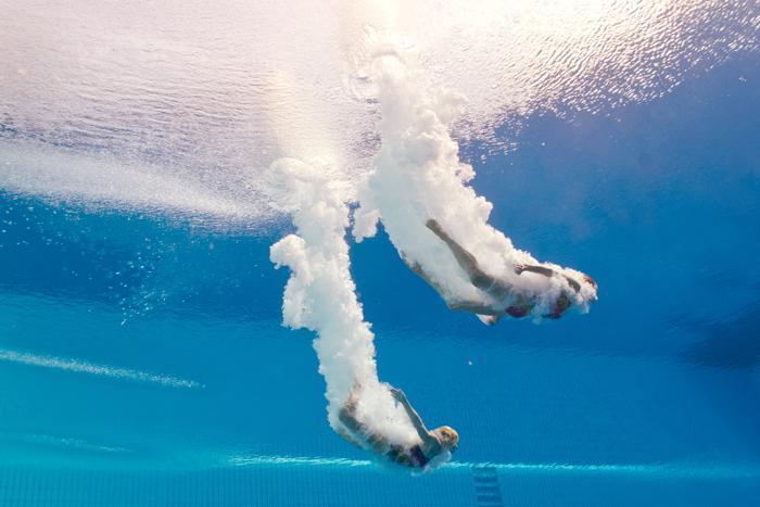 Россиянки Екатерина Петухова и Юлия Тимошинина стали восьмыми в прыжках с 10-метровой вышки на Чемпионате мира по водным видам спорта 22 июля 2013 года в испанской Барселоне. Фото: FRANCOIS XAVIER MARIT/AFP/Getty Images