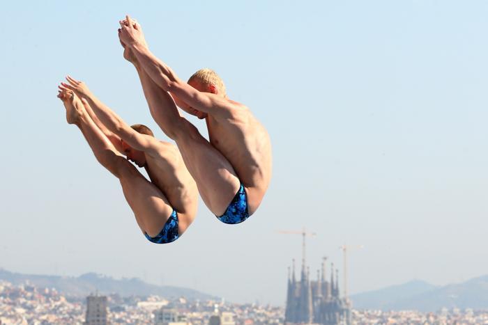 Прыгуны в воду Илья Захаров и Евгений Кузнецов взяли серебро на Чемпионате мира по водным видам спорта в испанской Барселоне 23 июля 2013 года. Фото: Quinn Rooney/Getty Images