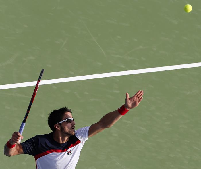 Николай Давыденко стартовал в Дубае с победы. Фото: KARIM SAHIB/AFP/Getty Images