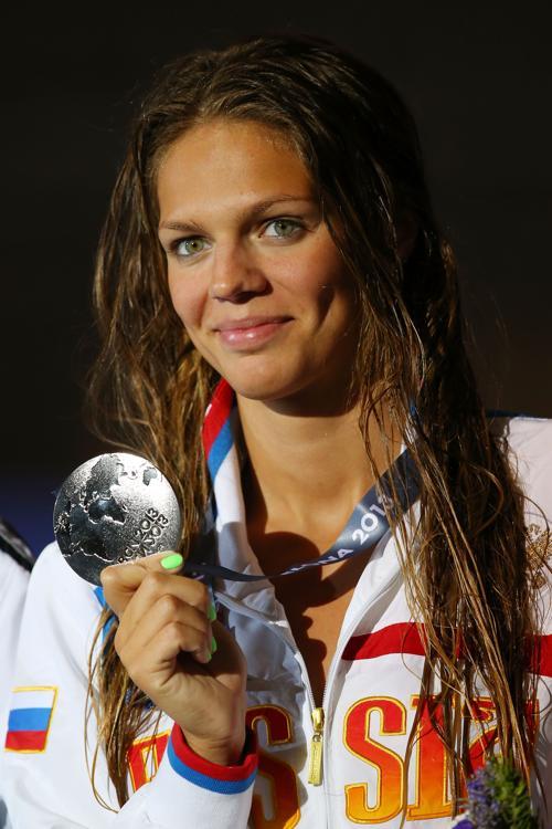 Юлия Ефимова завоевала серебряную медаль в плавании брасом на дистанции 100 метров в 11 день Чемпионата мира по водным видам спорта в испанской Барселоне 30 июля 2013 года. Фото: Clive Rose/Getty Images