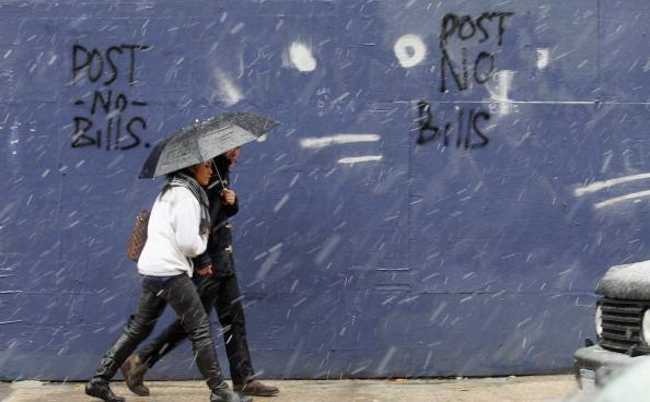 Фоторепортаж о сильном снегопаде на Восточном побережье США. Фото: Mario Tama/DON EMMERT/AFP/Getty Images