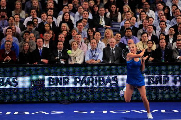 Мария Шарапова обыграла Каролин  Возняцки, но проиграла гольфисту Рори Макилрою. Фоторепортаж. Фото: Chris Trotman/Getty Images