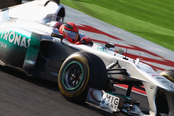 Себастьян Феттель   выиграл чемпионат «Формулы-1». Фоторепортаж с Гран-при Японии. Фото: Clive Rose/ Mark Thompson/Getty Images