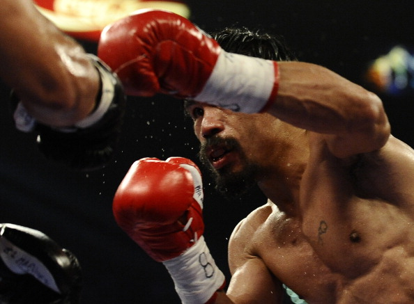 Мэнни Пакьяо выиграл бой у Хуана Мануэля Маркеса. Фоторепортаж  из Лас-Вегаса. Фото: read JEWEL SAMAD/AFP/Getty Images