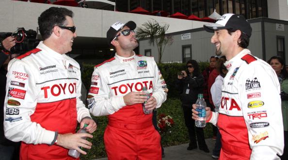 Комик Адам Каролла, и актеры Броди Дженнер и Эдриан Броуди на 36-й Toyota Pro Celebrity Race. Фоторепортаж. Фото: Фредерик М. Браун / Getty Images