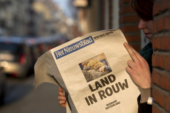 Бельгия скорбит по погибшим в автокатастрофе школьникам и их учителям. Фоторепортаж. Фото: Police Cantonale Valaisanne, Herman Ricou, SEBASTIEN FEVAL, STR/AFP/Getty Images