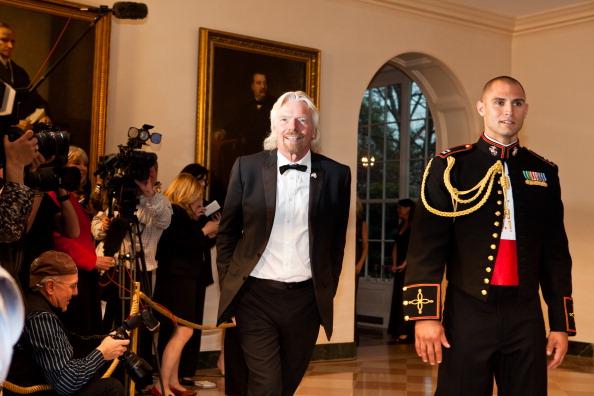 Гости на приеме в Белом доме. Richard Branson. Фоторепортаж. Фото: Brendan Hoffman, MANDEL NGAN/AFP/Getty Images