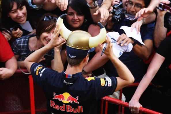 Фоторепортаж с соревнований «Формулы-1»: Марк Уэббер выиграл второй заезд гран-при  Испании, Петров  - на 12 месте. Фото: Paul Gilham/Vladimir Rys/Mark Thompson/ DIMITAR DILKOFF/AFP/Getty Images