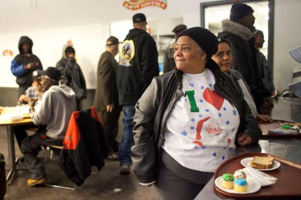 В столовой «Хлеб и жизнь святого Джонса» в Рождественские праздники. Фоторепортаж. Фото: Andrew Burton/Getty Images