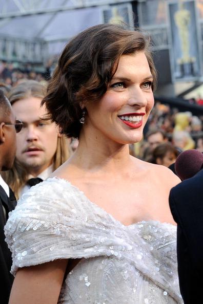 Милла Йовович на церемонии Annual Academy Awards в Голливуде. Фоторепортаж. Фото: Kevork Djansezian/Getty Images