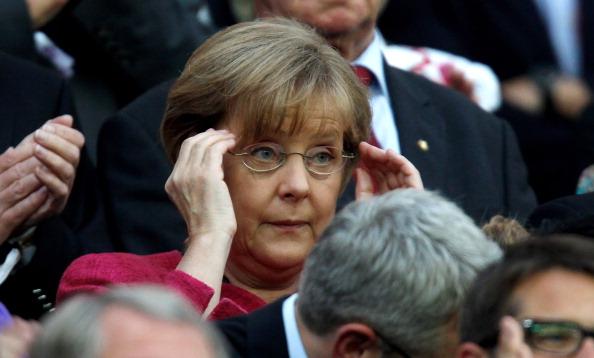 Ангела Меркель и Кристиан Вульф посетили  футбольный матч  женских команд Японии и США. Фото: Friedemann Vogel /Martin Rose / Joern Pollex /Thorsten Wagner /Christof Koepsel/Getty Images