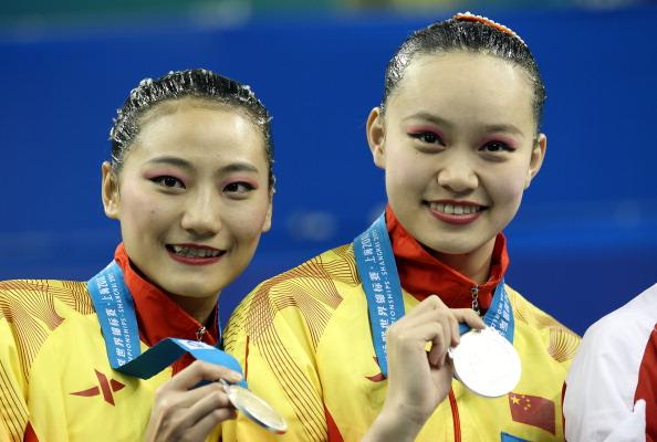 Серебряные  медали по синхронному плаванию в дуэте выиграли спортсменки Хуэн Сечен и Лю У из Китая. Фото:  Ezra Shaw/FRANCOIS XAVIER MARIT/AFP/Getty Images