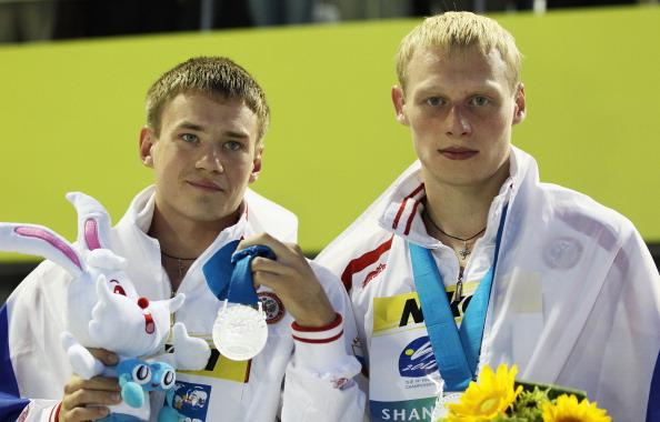 Евгений Кузнецов и Илья Захаров завоевали серебро в синхронных прыжках  в воду на чемпионате мира FINA. Фото:  Feng Li/Getty Images)