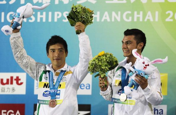 Фоторепортаж с соревнований по синхронным прыжкам в воду среди мужчин в четвертый день чемпионата  мира по водным видам спорта FINA, бронза досталась  мексиканцам Джулиану Санчесу  и Яхелю Кастильо. Фото:  Feng Li/Getty Images