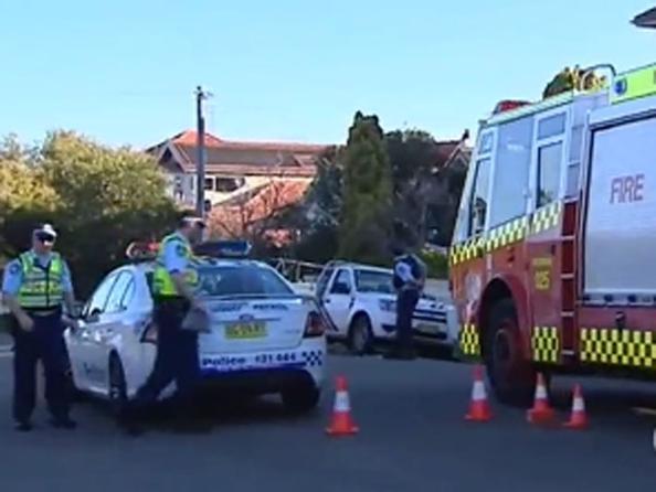 Полиция Австралии пытается спасти жертву вымогательства,  на шее которой закреплено взрывное устройство. Фото с сайта brisbanetimes.com.au
