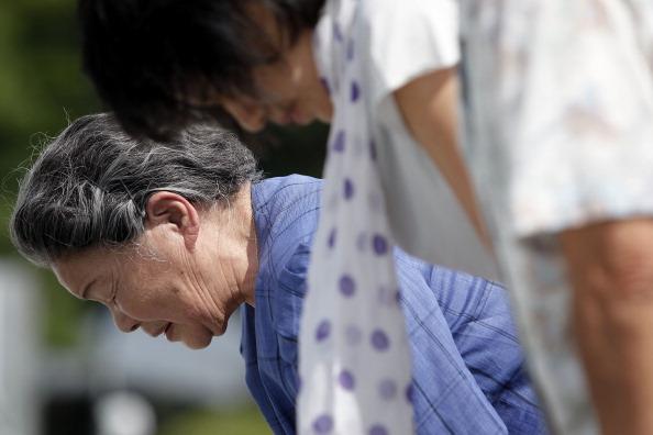Фоторепортаж из  Мемориального парка Хиросимы в канун 66-й годовщины атомного взрыва. Фото: Kiyoshi Ota/Getty Images