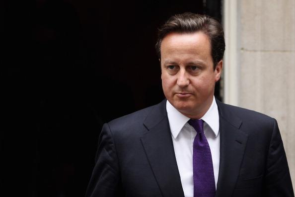 Первая тихая ночь с начала погромов в Лондоне. Дэвид Кэмерон.  Фото: Jeff J Mitchell/Dan Kitwood /Getty Images