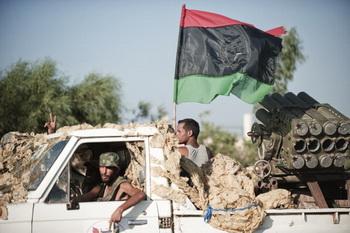 Бои ливийских повстанцев на юге Триполи. Фото: FILIPPO MONTEFORTE/AFP/Getty Images