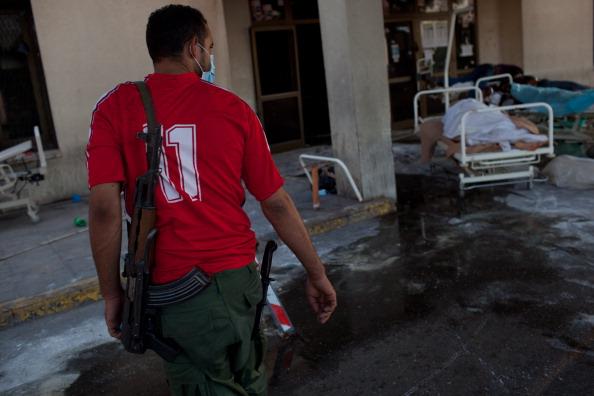 В больнице Ливии было обнаружено более 200  мертвых тел. Фоторепортаж из Абу-Салим. Фото: GIANLUIGI GUERCIA// PATRICK BAZ/AFP/Getty Images