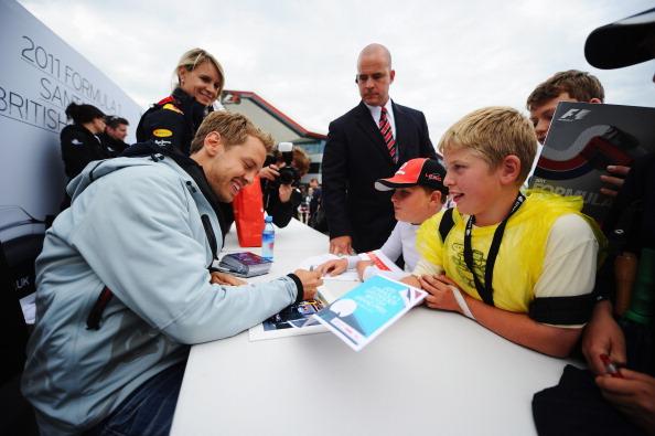Себастьян Феттель  выиграл третий этап «Формулы-1» Гран-при Великобритании. Фоторепортаж с  трассы «Сильверстоун». Фото: Фото:  Mark Thompson/ Clive Mason/ Paul Gilham /Getty Images