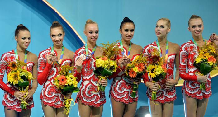 Российская команда по художественной гимнастике на чемпионате мира в Киеве 31 августа 2013 года. Фото: SERGEI SUPINSKY/AFP/Getty Images