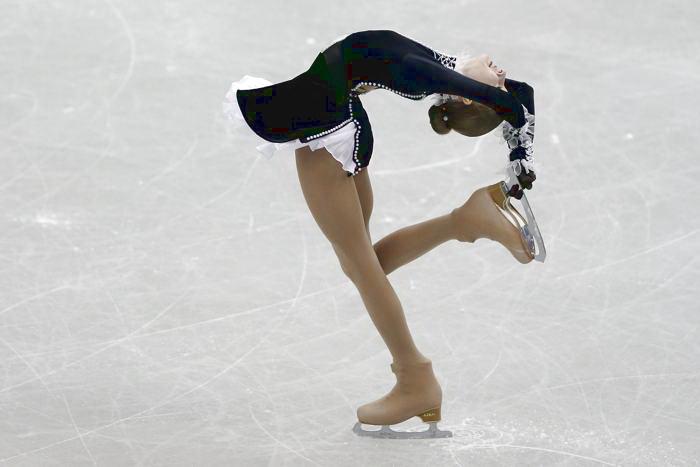 Мария Соцкова выступила с короткой программой в первый день Гран-при в японской Фукуоке 5 декабря 2013 года. Фото: Chris McGrath / Getty Images