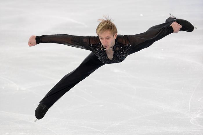 Евгений Плющенко выступил 9 февраля в командном турнире по фигурному катанию на Олимпиаде в Сочи. Фото: ANDREJ ISAKOVIC/AFP/Getty Images