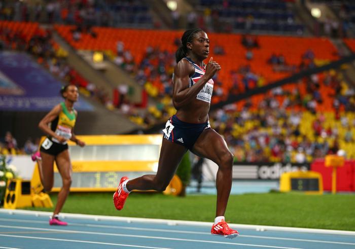 Российская бегунья Антонина Кривошапка 12 августа 2013 года в упорной борьбе финишировала третьей на дистанции 400 метров в московских «Лужниках» на ЧМ по лёгкой атлетике. Фото: Cameron Spencer/Getty Images