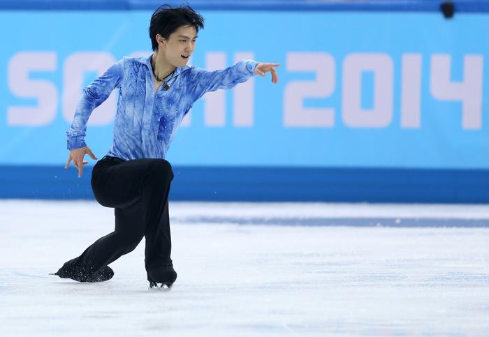 Японец Юзуру Ханю исполняет короткую программу на Олимпиаде в Сочи 13 февраля 2014 года. Фото: Matthew Stockman/Getty Images
