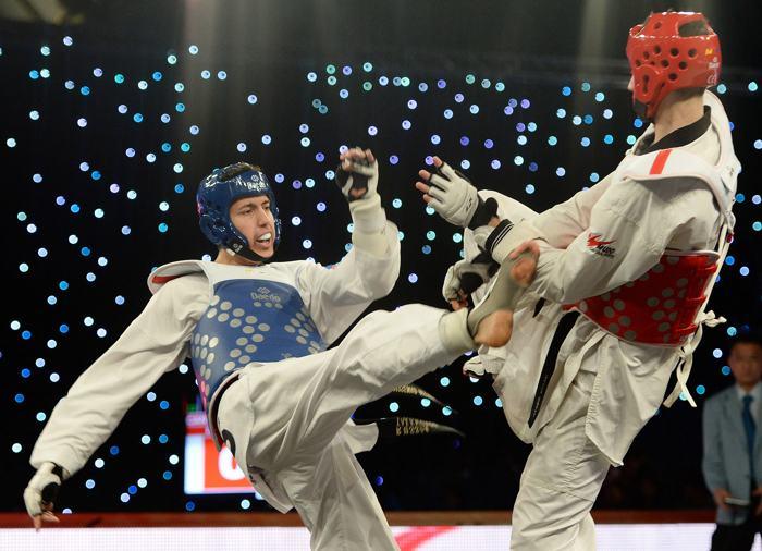 Алексей Денисенко стал победителем соревнований мирового Гра-при по тхэквондо в категории до 68 килограммов 15 декабря 2013 года. Фото: Nigel Roddis Getty Images
