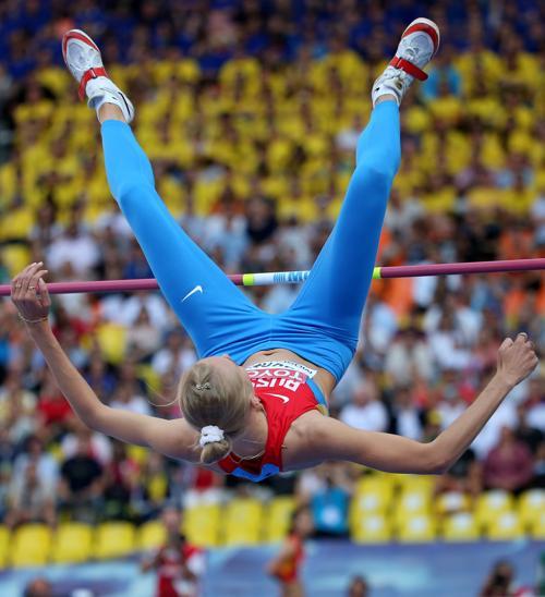 Россиянка Светлана Школина смогла взять высоту 2 метра 3 сантиметра, установив личный рекорд в карьере на чемпионате мира в московских «Лужниках» 17 августа 2013 года. Фото: FRANCK FIFE/AFP/Getty Images