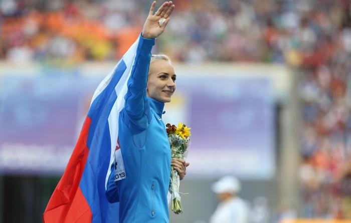 Россиянка Светлана Школина смогла взять высоту 2 метра 3 сантиметра, установив личный рекорд в карьере на чемпионате мира в московских «Лужниках» 17 августа 2013 года. Фото: ALEXANDER NEMENOV/AFP/Getty Images