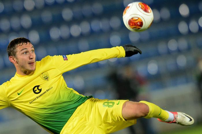 Нападающий «Анжи»  Никита Бурмистров в матче с командой «Тромсе» из Норвегии 24 октября 2013 года на стадионе в Раменском. Фото: KIRILL KUDRYAVTSEV/AFP/Getty Images