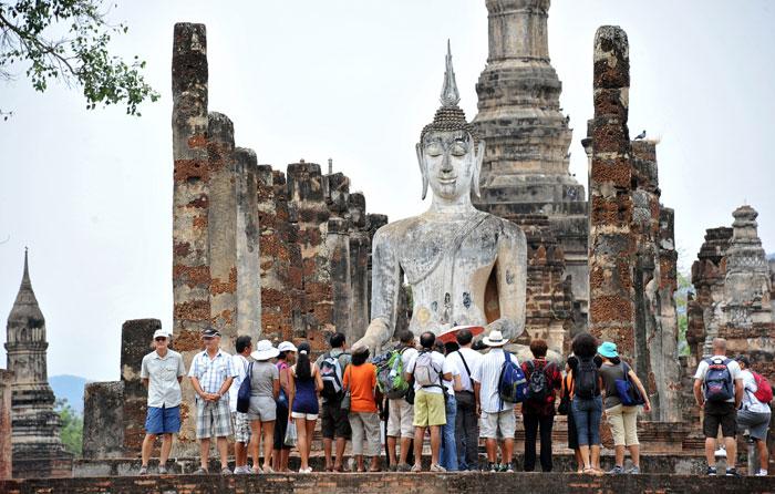 Гигантские Будды в Королевстве Сукхотхай, Таиланд. Фото: PHILIPPE HUGUEN/AFP/Getty Images