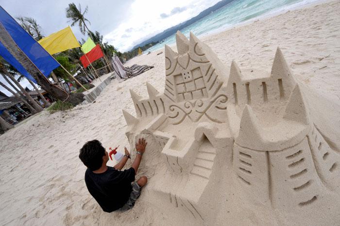 Филлипинский пляж. Вывоз песка с пляжа запрещён. Фото: JAY DIRECTO/AFP/Getty Images