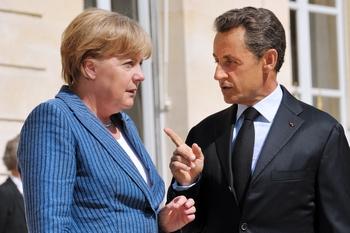 Меркель и Саркози решили спасти евро в марте. Фото: PHILIPPE WOJAZER/AFP/Getty Images