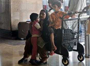 Сегодня международный день иммигрантов. Фото:  RIZWAN TABASSUM/AFP/Getty Images
