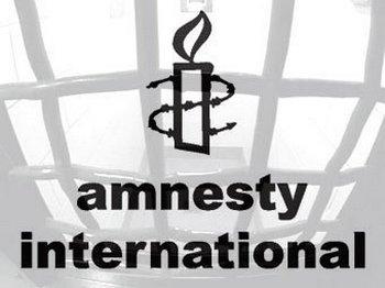 Amnesty International - символ организации. Фото с сайта amnesty.org