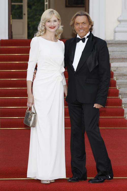 дизайнер Отто Керн со своей супругой Наоми Велеска Керн  в Берлине посетили правительственный ужин.  Фоторепортаж. Фото: Andreas Rentz/Getty Images