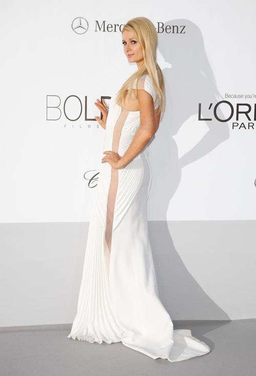 Знаменитости на мероприятии 2012 amfARs Cinema Against AIDS во Франции. Paris Hilton. Фоторепортаж. Фото: Andreas Rentz/Getty Images