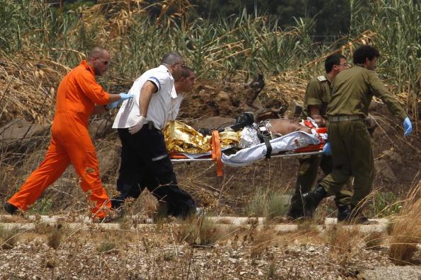 В перестрелке на границе Израиля с Ливаном погибли четверо военных и журналист. Фоторепортаж. Фото: JACK GUEZ/AFP/Getty Images