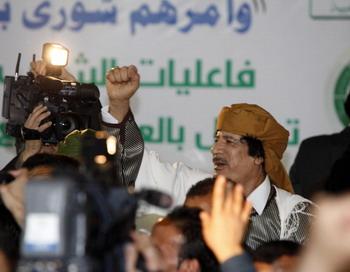 Муамар Каддафи подозревается в преступлениях против человечности. Фото: MAHMUD TURKIA/ AFP/Getty Images
