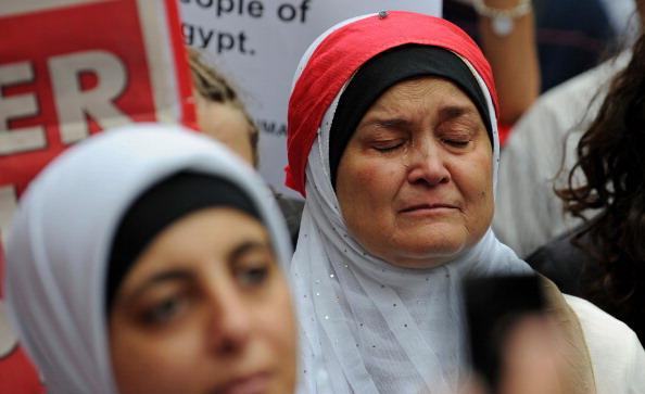 Хосни Мубарак покинул пост главы Египта. Фоторепортаж. Фото: PEDRO UGARTE, GREG WOOD,  /AFP/Getty Images